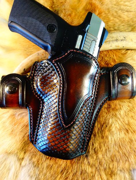 Hand tooled leather holsters, concealed carry