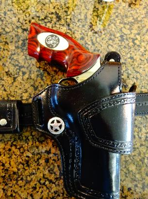 Revolver holsters, leather holsters